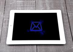 Graphic tablet computer pc gadget letter symbol blue on wooden board Stock Photos