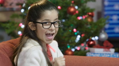 Little girl happy about Christmas Stock Footage