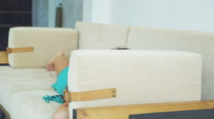 Girl fooling around on the couch Stock Footage