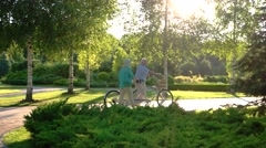 Couple with bicycle is walking. Stock Footage