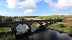 Vehicles on bridge over River North Esk Angus Scotland Stock Footage