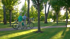 Couple walking with bicycle. Stock Footage