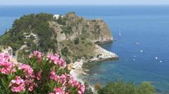 Oleander flowers and Mazzaro bay. Near Taormina, Sicily, Italy. Stock Footage