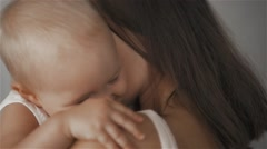 Mother and Baby. Happy Family. Mom With her Child smiling and laughing at home Stock Footage