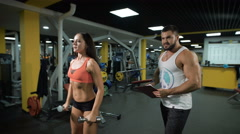 Fitness instructor and client at the gym Stock Footage