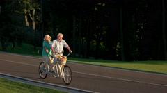 Senior couple on country bike ride Stock Footage