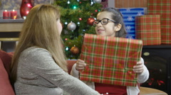 Little girl opening a Christmas present Stock Footage