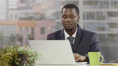 Businessman using a laptop in an office Stock Footage