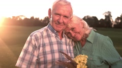 Smiling senior couple with bouquet Stock Footage