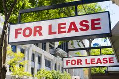 For Lease signs on display outside buildings Stock Photos