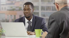 Businessmen working together in an office Stock Footage