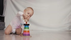 Baby girl playing with educational toy in nursery. Logic child game Stock Footage