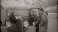 Car engine trouble on mountain road delays trip, 3713  vintage film home movie Stock Footage