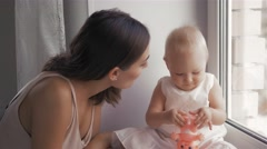 Young Happy Mother Holding her Newborn Child. Family at home. Beautiful smiling Stock Footage