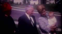 Family members hold the newborn for the camera 3717 vintage film home movie Stock Footage