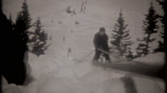 Skiiers use rope line, pull themselves up mountian, 3714 vintage film home movie Stock Footage