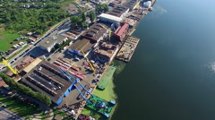 Aerial Shipyard Construction Site Over The River Stock Footage