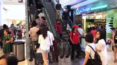 Timelapse view of shoppers in Suria KLCC Mall interior Stock Footage