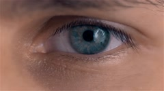 Beautiful blue man eyes with conatc lense close up Stock Footage