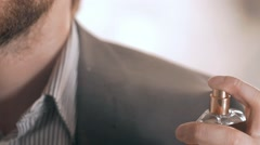 Close up of handsome young business man using perfume Stock Footage