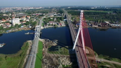 Aerial cable-stayed bridge on a river in Gdansk, Poland Stock Footage