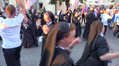 WYD Krakow 2016 - happy nuns group dancing in street - magic hour light Stock Footage