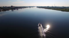 Aerial View Of Boat On a River Going Towards the Sun Stock Footage