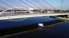 Aerial View Of Boat Going Under Cable-Stayed Bridge Stock Footage