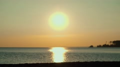 He silhouettes of two people on the beach with bikes Stock Footage