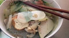 Vietnamese cheap vegetarian noodle soup - hu tieu chay Stock Footage