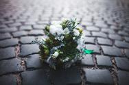 Wedding bouquet on the paving stones Stock Photos