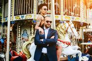 Adult man and woman on a carousel Stock Photos