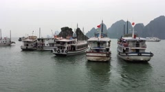 A cruise ship traversing through Ha Long Bay Stock Footage