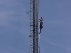 Tower climber in a cell tower, working on cables at height Stock Footage