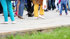 People cross the road at a pedestrian crossing. Stock Footage