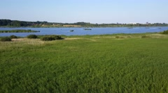 Countryside landscape with a lake in Arhus Stock Footage