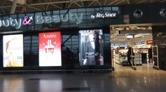 People inside duty free store in Vnukovo international airport in Moscow. Time Stock Footage