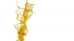 Yellow splash in the air. slow motion. syrup Stock Footage
