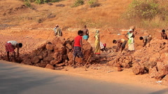 Unidentified people construction road in India Stock Footage