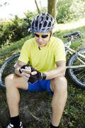 Mountainbiker with smartphone Stock Photos