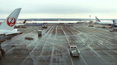 Landing airplanes, waiting for takeoff permission aircrafts on runway Stock Footage