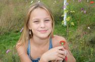 Beautiful young girl with a flower in the park Stock Photos