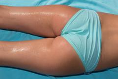 Back view of girl bottom legs and hips with bikini Stock Photos