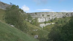 4K Peak of Malham Cove Cliff Lime Stone Rocks Countryside Stock Footage