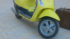 Yellow motor scooter. Stock Footage
