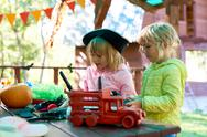 Two little girls playing outdoors on Halloween party Stock Photos