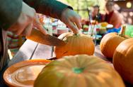 Close-up of male hands carving a pumpkin Stock Photos