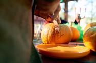 Man carving pumpkin for Halloween party Stock Photos