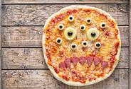 Halloween scary food monster zombie face pizza snack with mozzarella and sausage Stock Photos