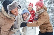 Group of friends having fun in winter day Stock Photos